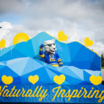 The Nook dances on board UAF's 2016 Golden Days parade float as UAF students, staff, faculty, alumni and administrators participate in representing the university.